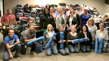 Dentsply Sirona Endodontics employees prepare to deliver donations to Youth Services Tulsa