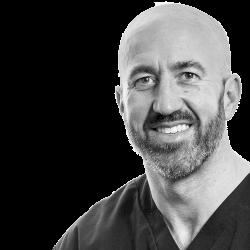 Dr. Paul Swanson BDS MFGDPUK DipImpDentRCSEng MSc (Implant)